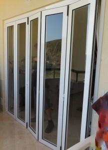 Puertas plegables carpinteria de aluminio en tenerife aluminium design - Puertas plegables de aluminio ...